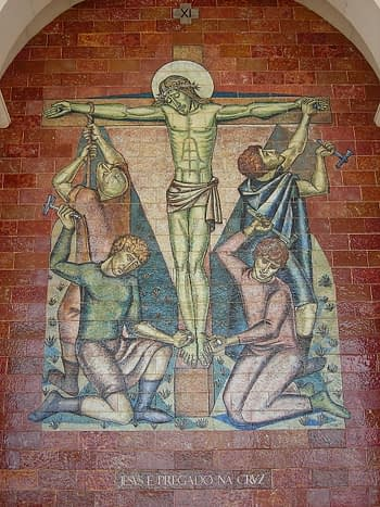 11the station Jesus is nailed to the cross