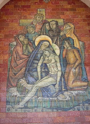 Jesus is taken down from the cross and given to his mother