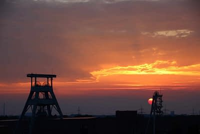 Fountain tower of the Ewald colliery in the Ruhr area at sunset