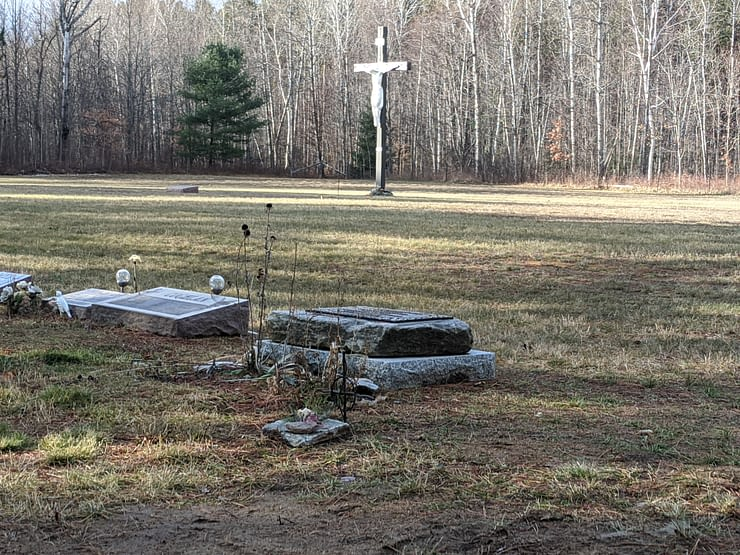 Looking toward the crucifix across my mother's grave and the plot for those babies who died in their mother's womb.
